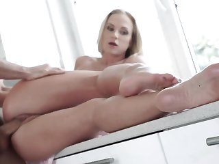 A hot bitch is on climax of a counter, getting fucked well