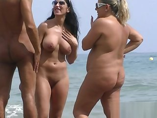 Nudist beach voyeur shoots naked babes sunbathing