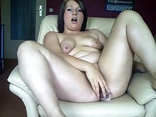 Chubby German girl fucks her ass together with pussy with dildos