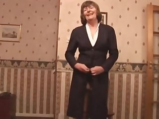 Sweet granny in stockings increased by girdle shows off hairy pussy