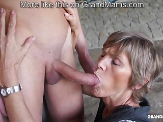 Horny old cougar tapes up her young toyboy and sucks him absent