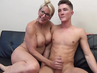 Mature light-haired female with glasses is fumbling her step- sonny's man meat after railing well supplied a pile