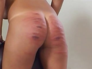 Slut enjoys having her ass spanked permanent off out of one's mind a dominant blonde