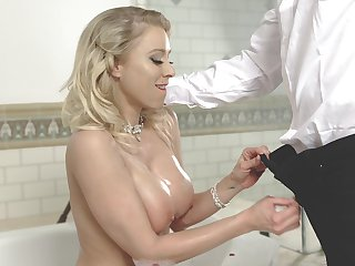 After bathing big breasted MILF is reachable to give a nice titjob to her stud