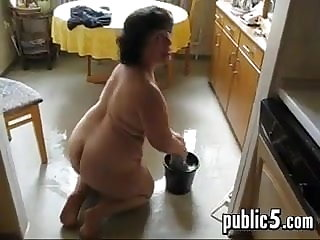 Mature BBW washes the floor and masturbates