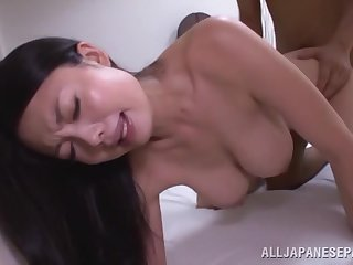 Addictive Asian MILF shakes them big naturals in the most remarkable doggy