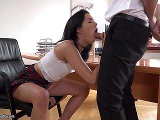 Brunette Anainda demonstrates her blowjob genius nearly her boss